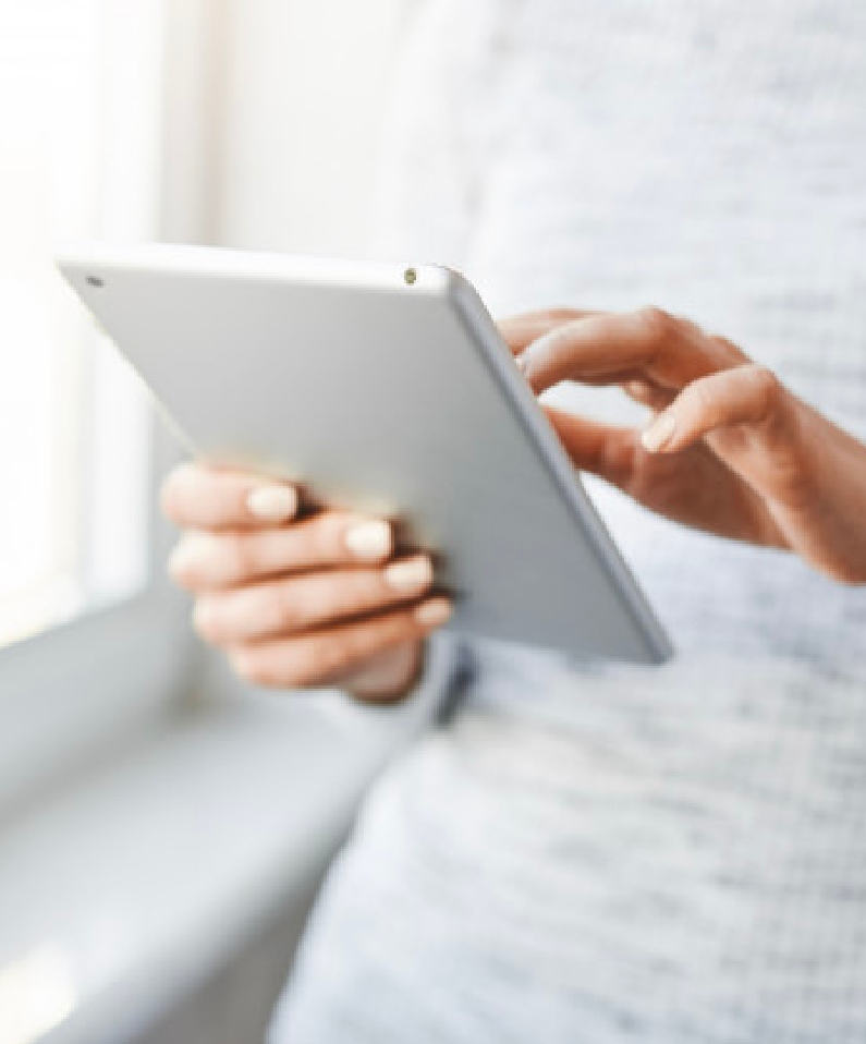 A person holding a tablet